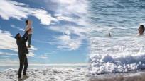 Zirvede kar sahilde deniz keyfi