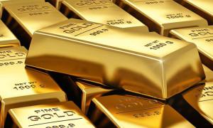 Altın doların kazançlarını koruması ile düştü
