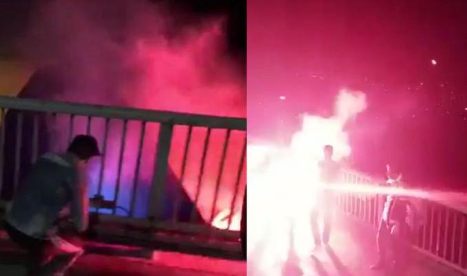 Beşiktaşlı taraftarlar köprüdeki Fenerbahçe bayrağını yaktı