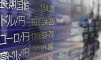 Asya borsaları Fed'in kararıyla karışık seyretti