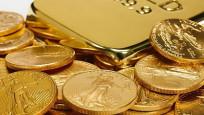 Altın ticaret gelişmeleri ile düşüşünü sürdürdü