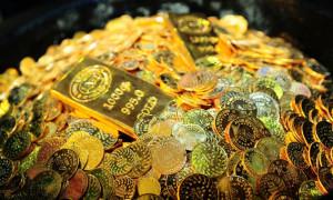 Altın ticaret gelişmeleriyle kayıplarına tutundu