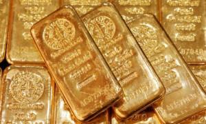Altın Fed'in faiz indirimi beklentisi ile kazancını korudu