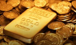 Altın Fed öncesi 14 ayın zirvesi yakınında seyretti