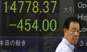 Asya borsaları Fed'in faiz kararı sonrası karışık bir seyir izledi