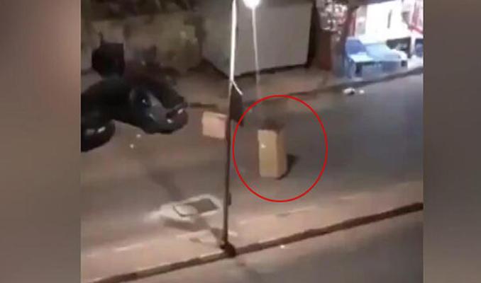 Sokağa çıkma yasağına takılmamak için karton koli kılığına girdi
