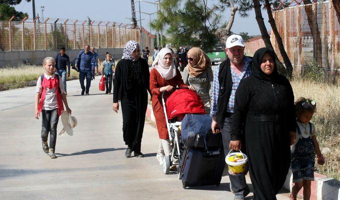 Suriyeliler, ülkelerine tatile gidiyor! ile ilgili görsel sonucu