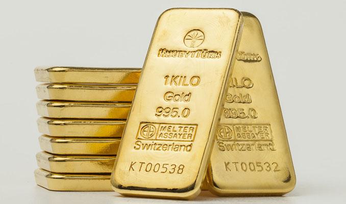 Altın güçlü dolar ile kayıplarını korudu