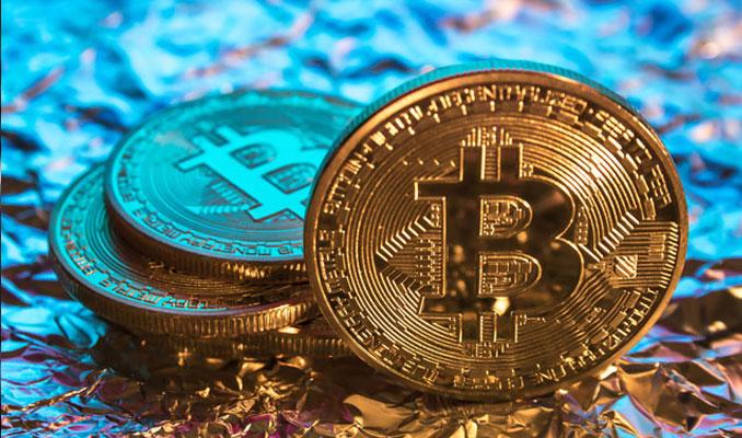 Bitcoin 12 bin doları test etti