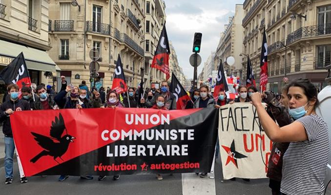 İşçiler, göçmenler Macron'a karşı büyük protesto