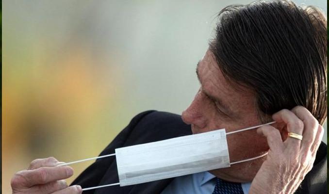 Gazeteciler maskesini çıkaran Bolsonaro'ya dava açıyor