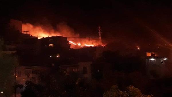 Bodrum'da, yerleşim yeri yakınındaki otluk alanda çıkan yangın korkuttu